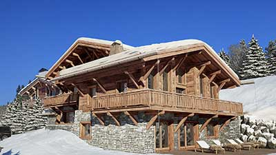 Photographie en image de synthèse d'un chalet de luxe à la montagne.